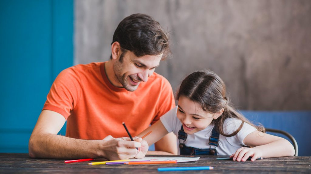 Father painting with daughter on fathers day.