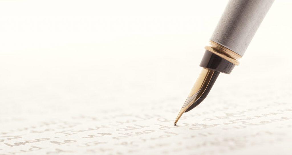 Fountain Pen on Written Page.