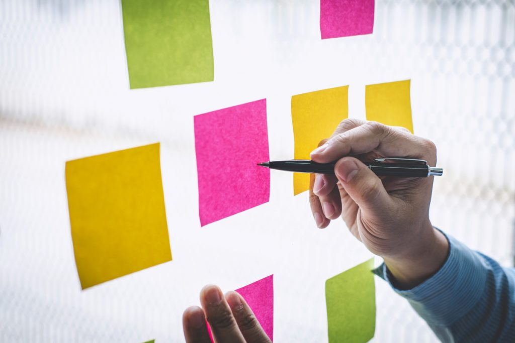 Businessman use post it notes to planning idea and business marketing strategy.